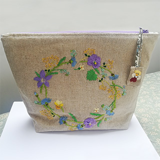 Handmade linen bag with embroidered flowers